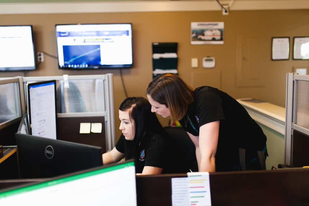 Staff working at computer