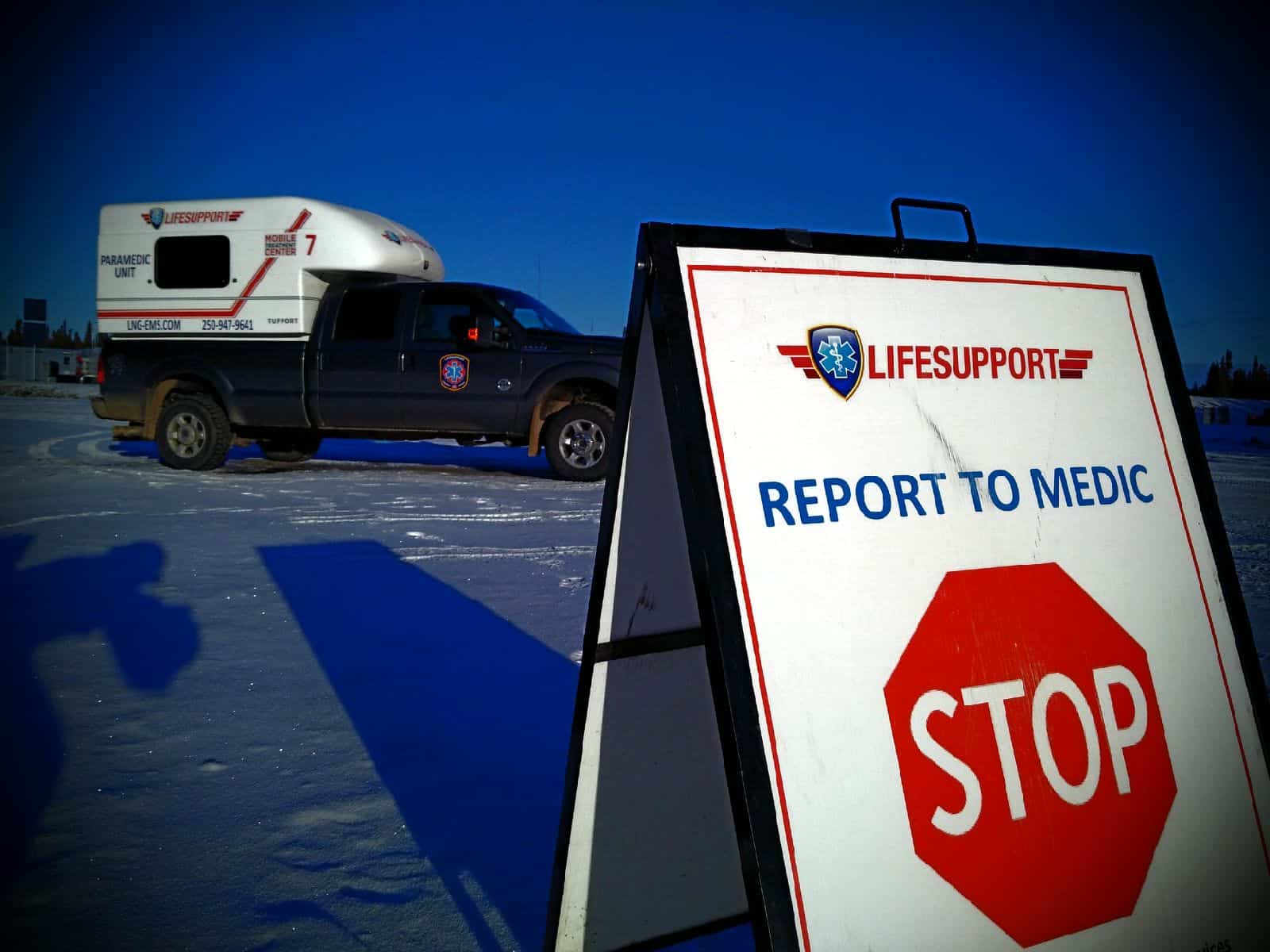 LIFESUPPORT truck and stop sign