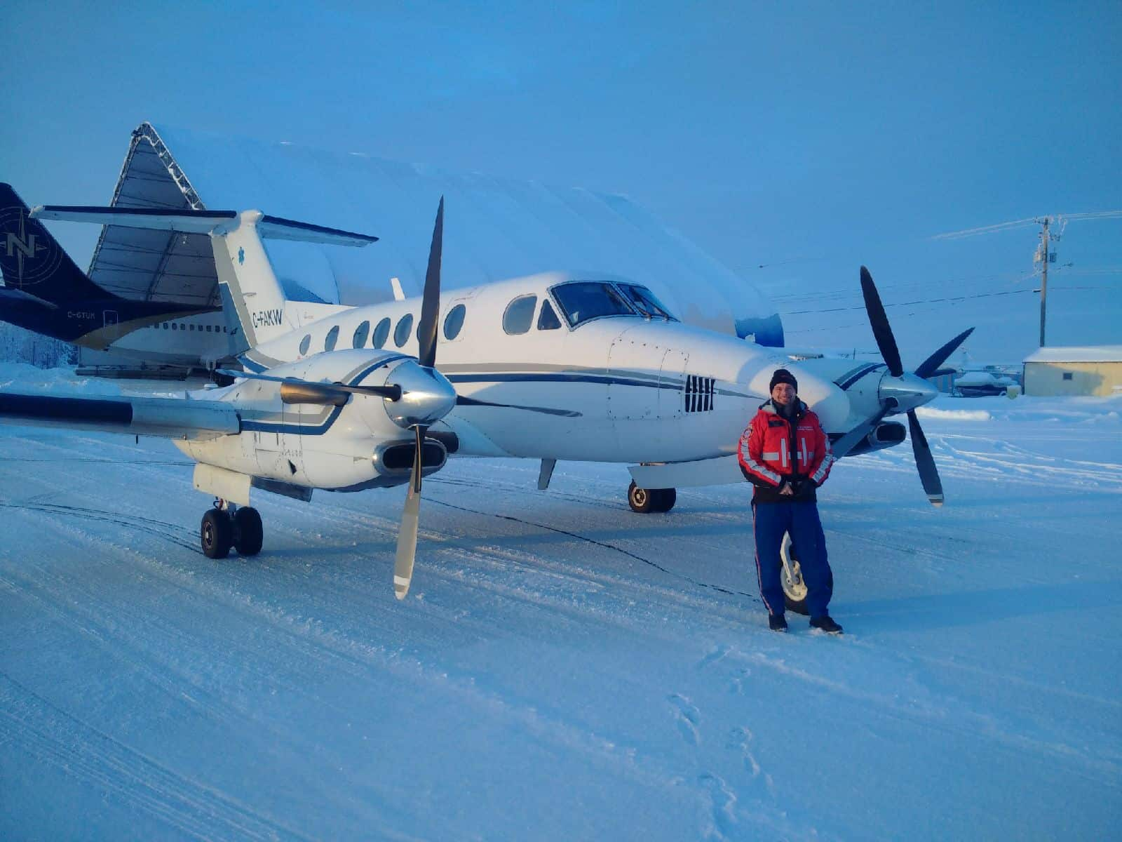 Man standing with plane
