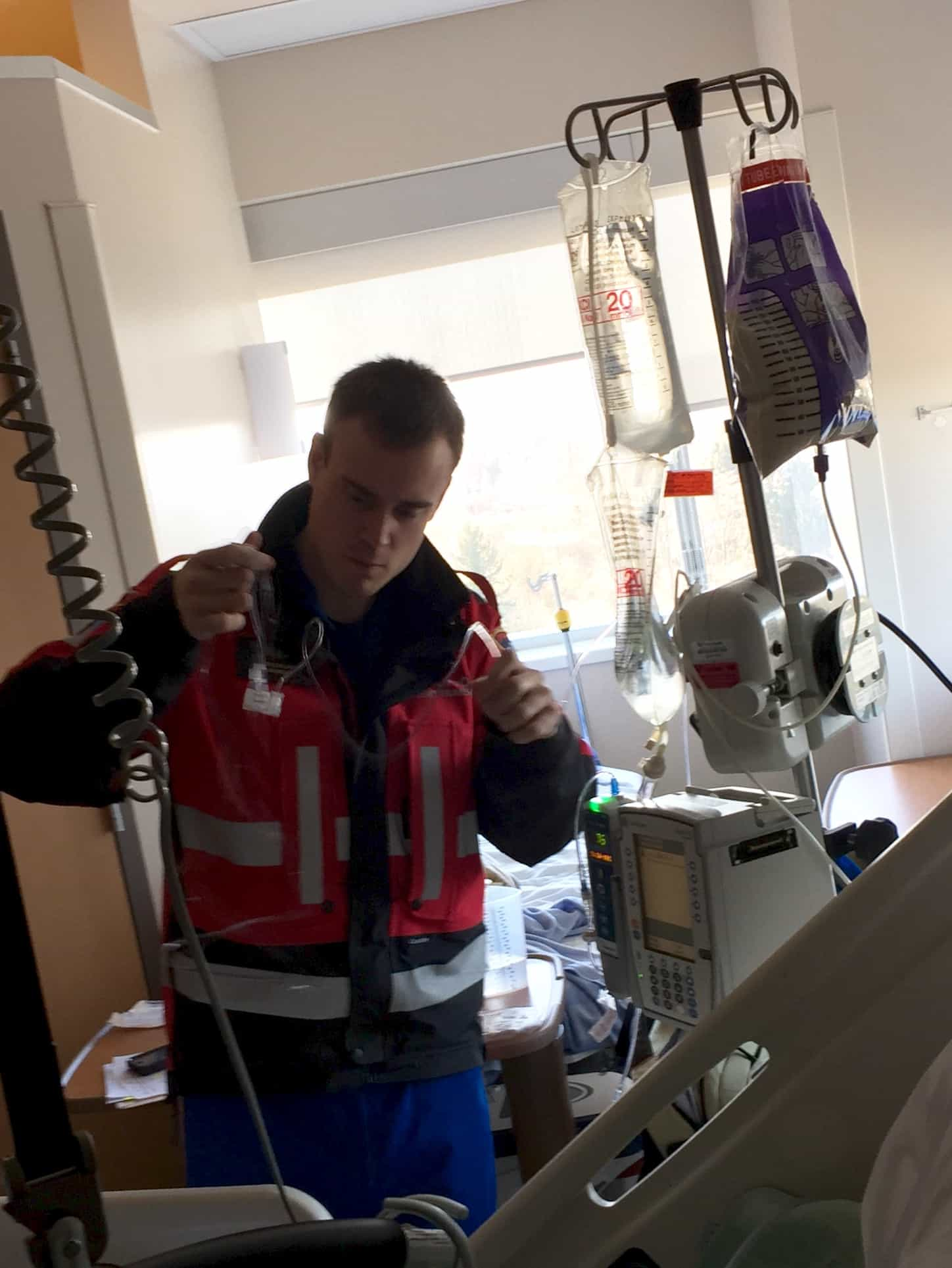 Paramedic with medical equipment
