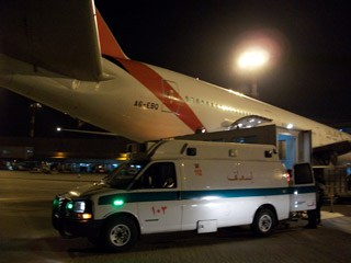 Ambulance with plane at night