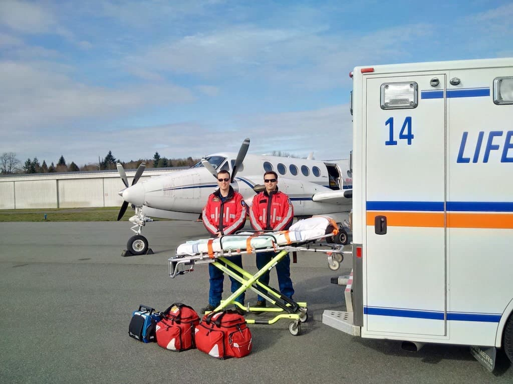 Paramedics patient transport LIFESUPPORT Air Ambulance